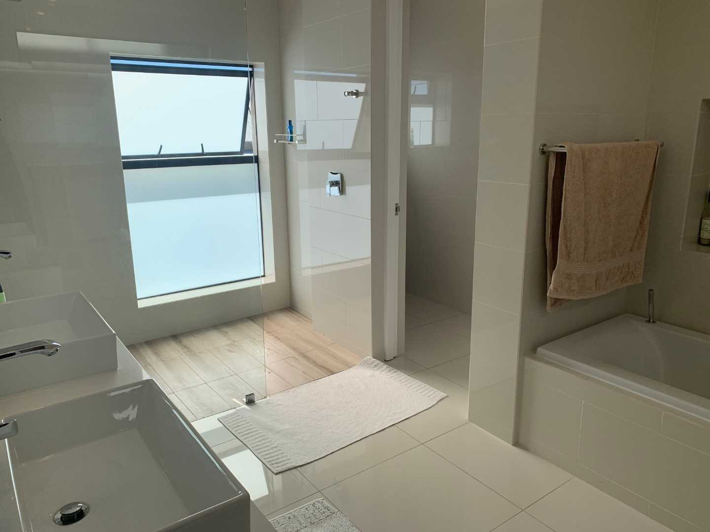 Full bathrooms with separate toilet, his and hers basins, walk-in shower and bath.