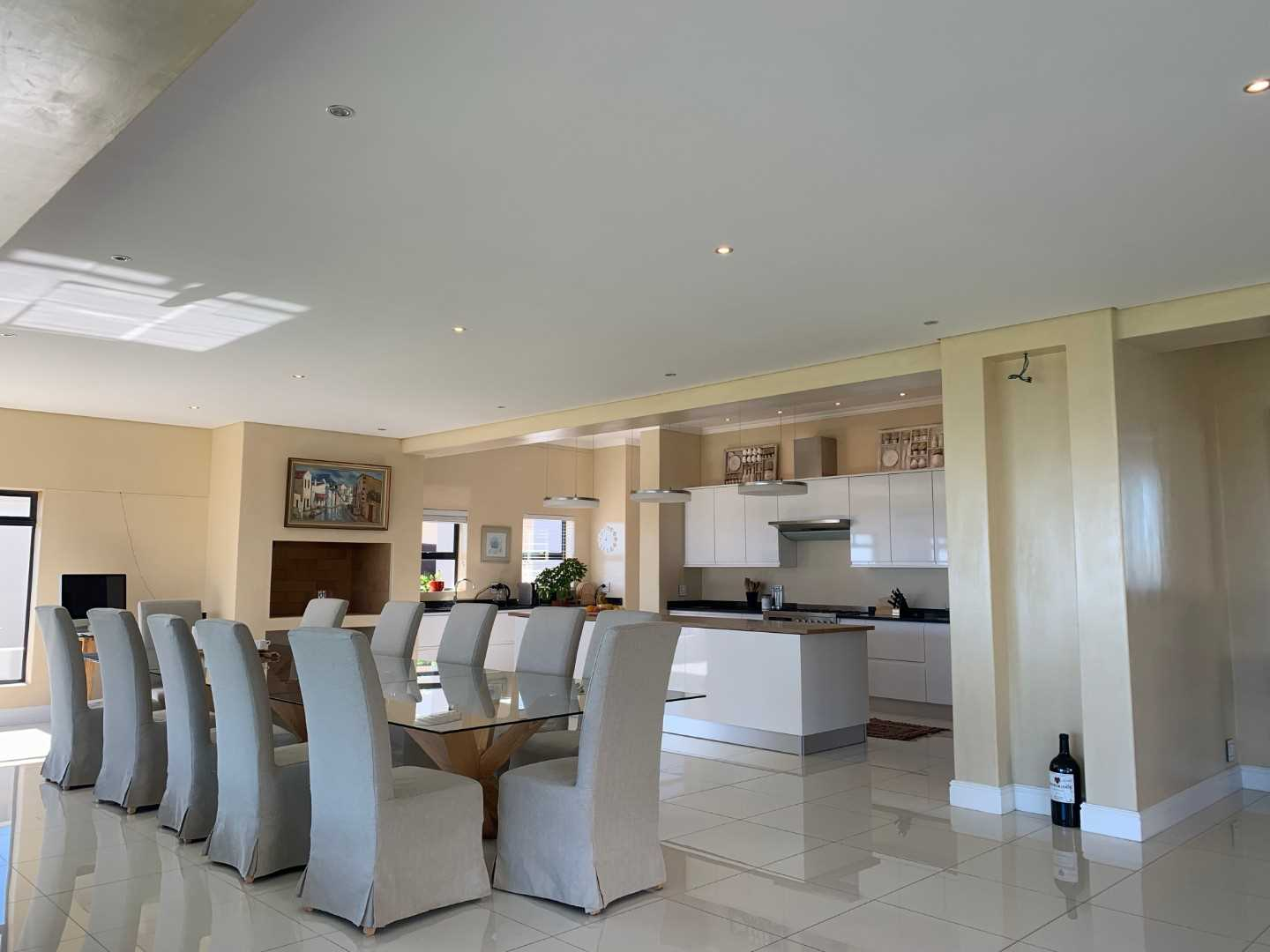 Open plan living with indoor Braai / barbeque and formal dining area. Views have both a western and northern outlook.