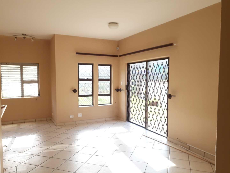 Open plan lounge area leading to kitchen