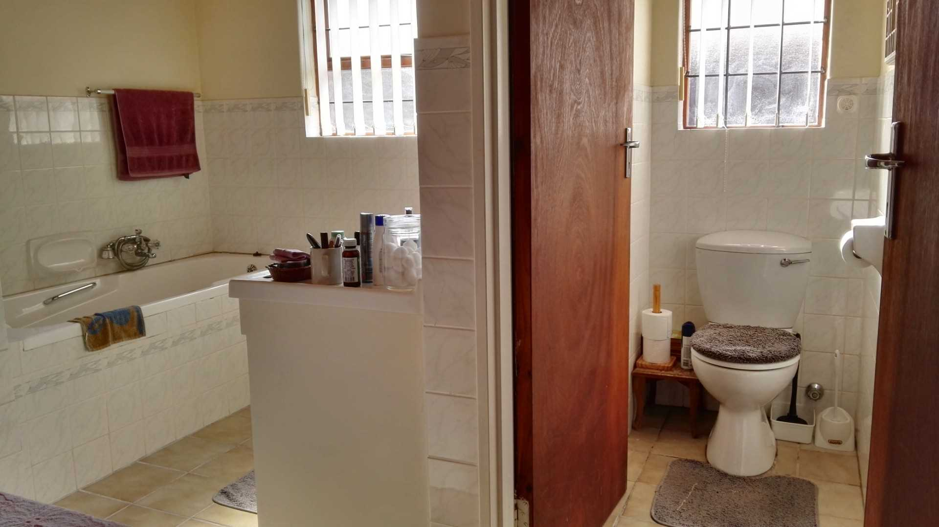 En-suite bathroom for main bedroom with bath, shower, double basin and separate toilet