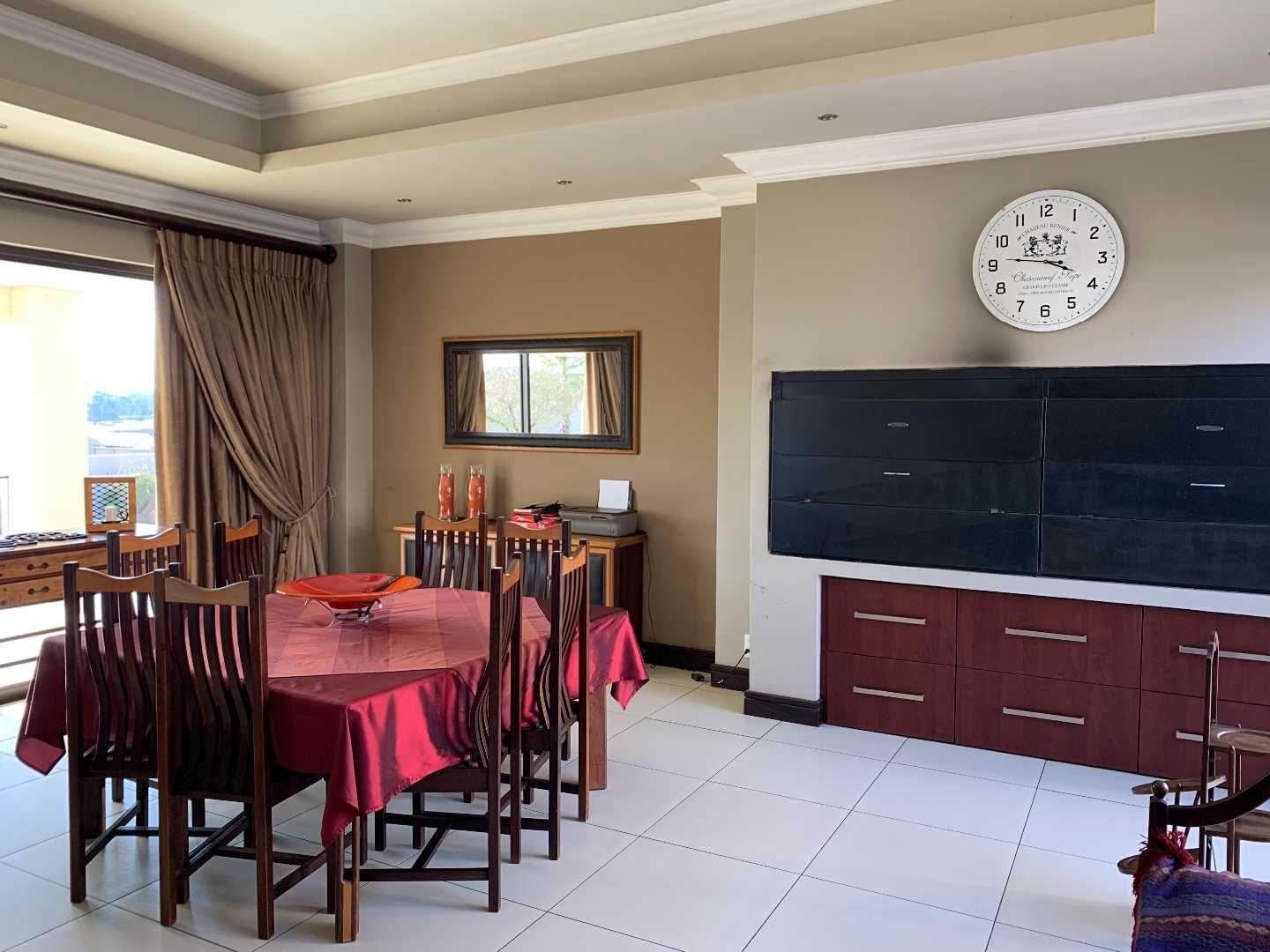 Spacious indoor entertainment braai area with sliding doors leading out to the large covered patio