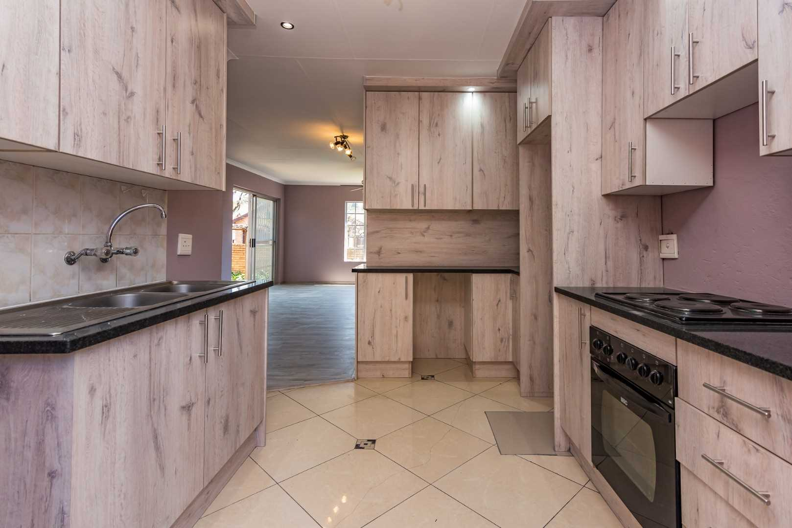 Designer Kitchen leads onto open living areas