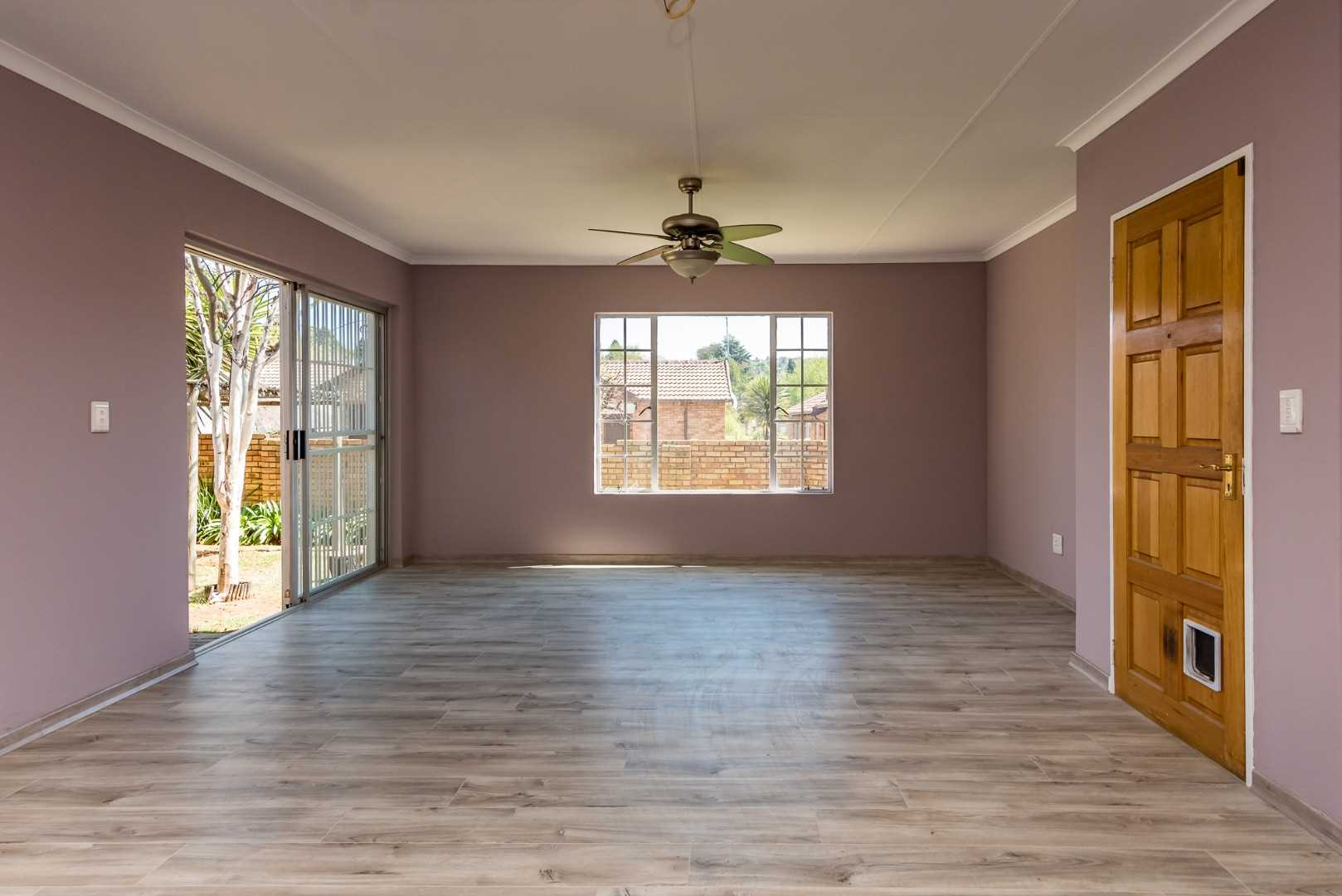 Grand entrance into spacious living areas with new laminating flooring and newly painted