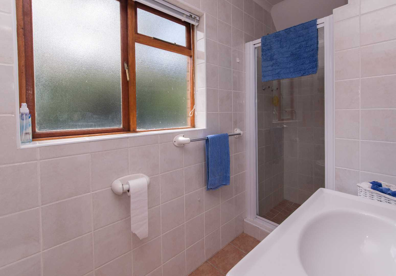 bathroom in flat - shower, toilet and basin