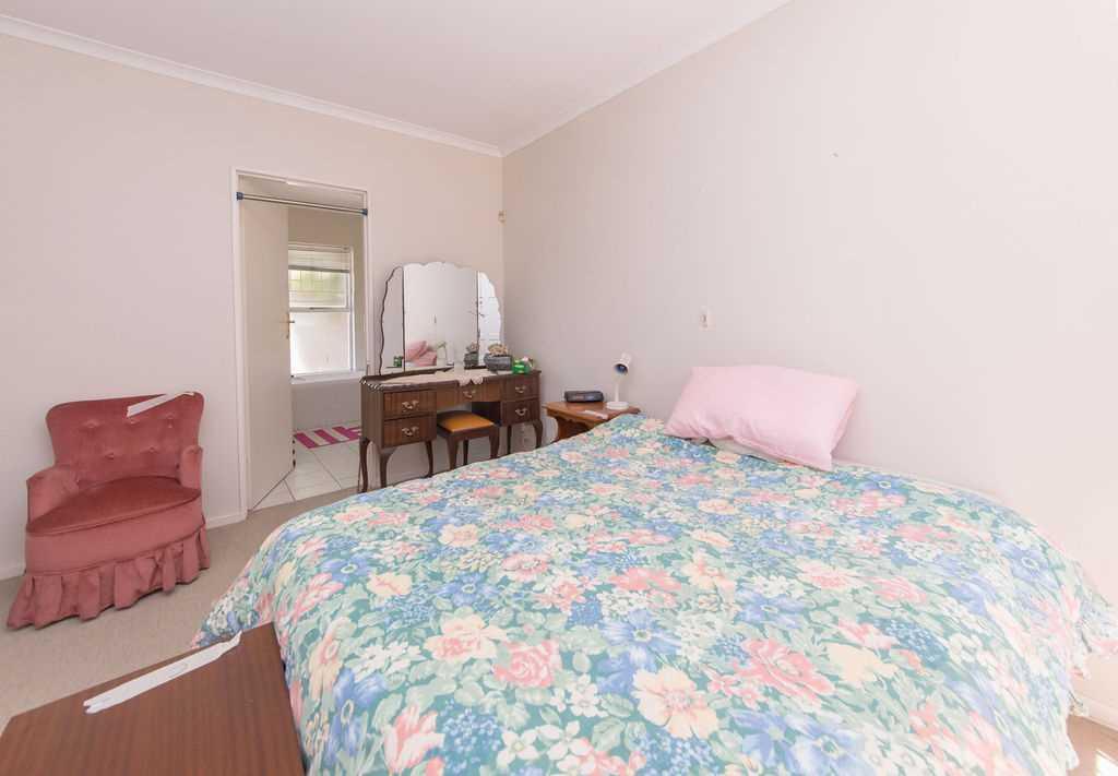 Main bedroom with en-suite bathroom beyond