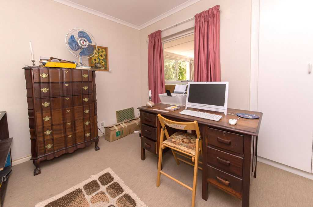 Third bedroom or study with built in cupboards