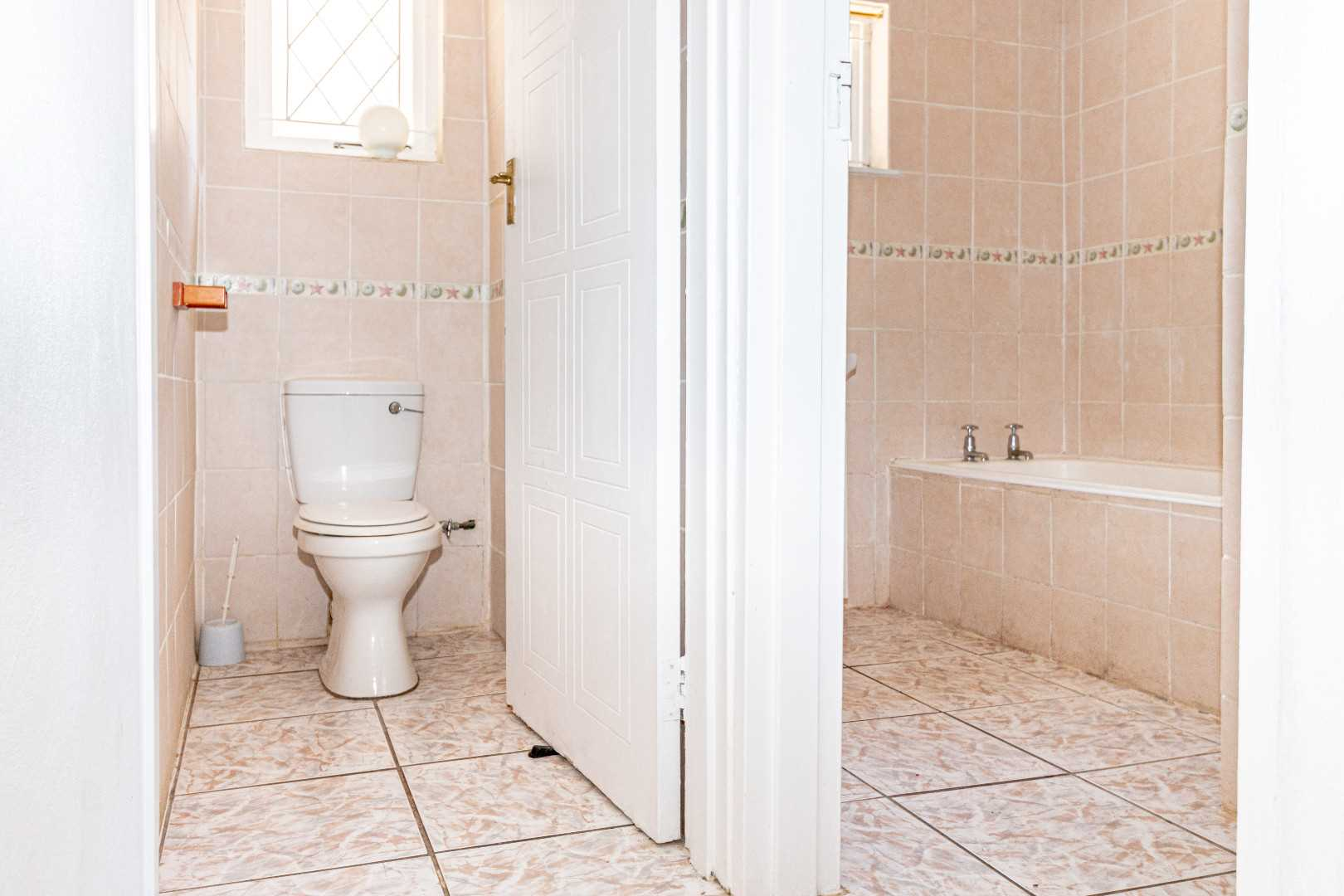 Bathroom: bath & shower with separate toilet