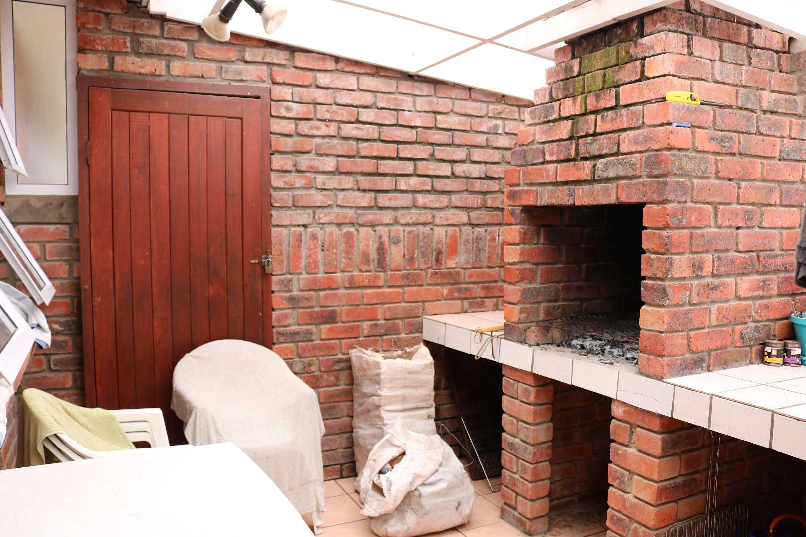 ENCLOSED ENTERTAINMENT AREA OUTSIDE BACK DOOR