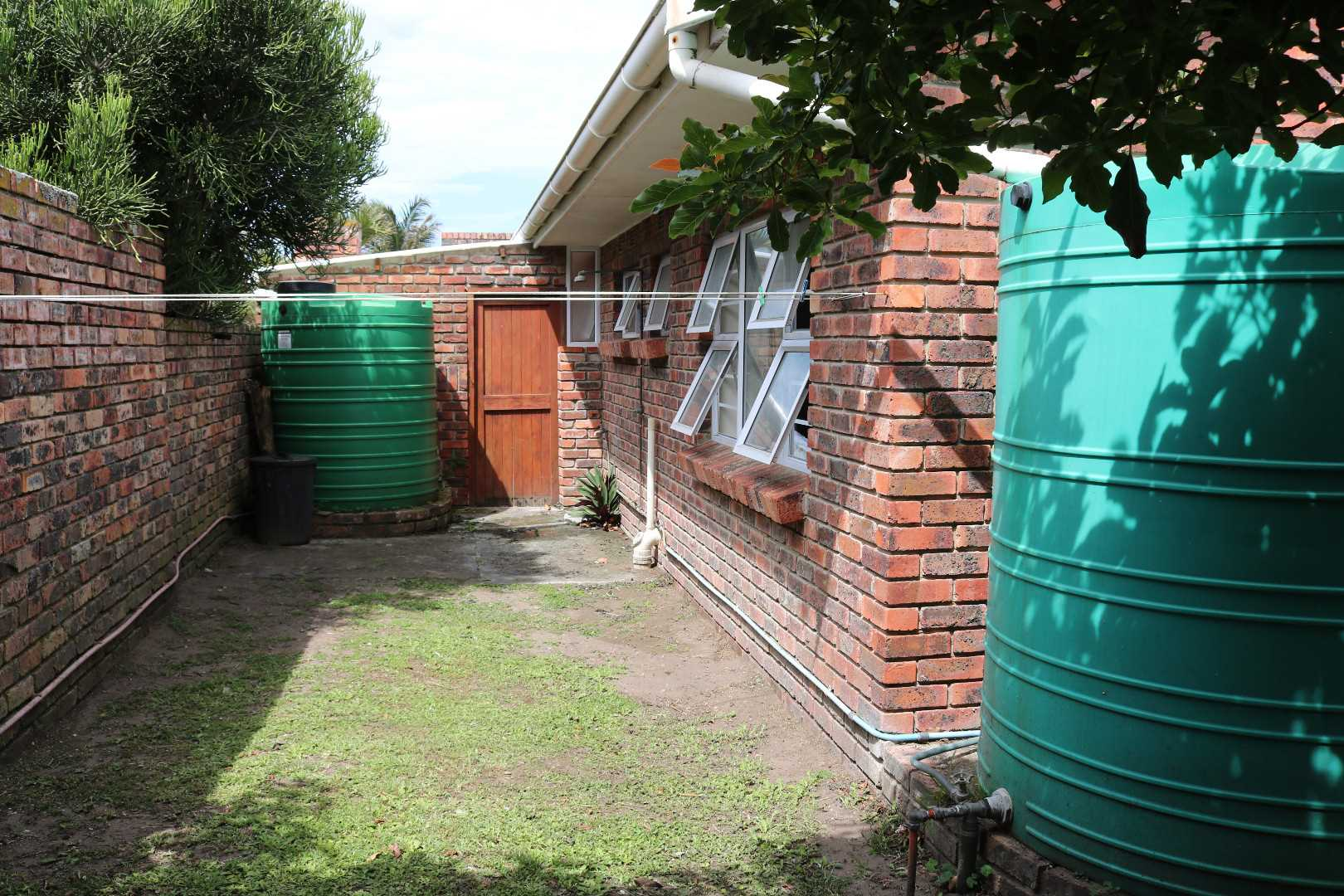 BACK YARD AREA WITH WATER TANKS