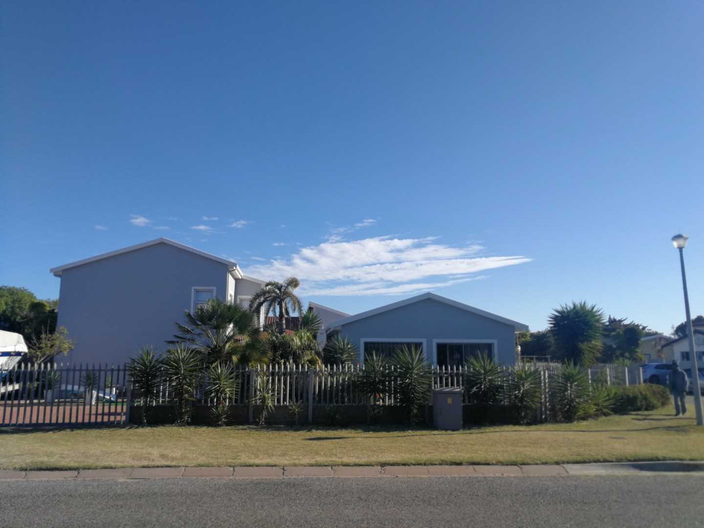 Large home on a corner plot in walking distance to the beach.