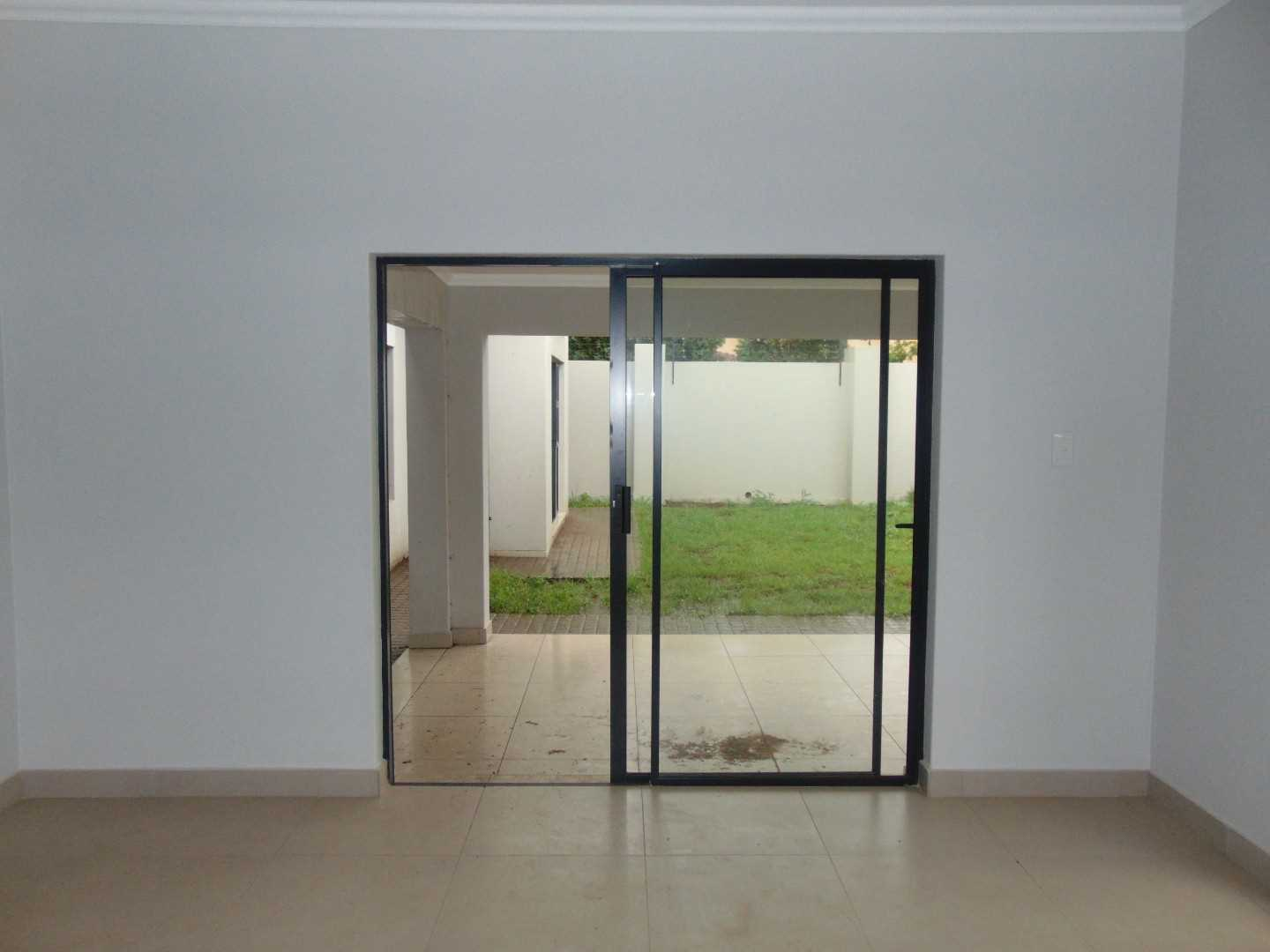 the sliding door to the patio and garden.