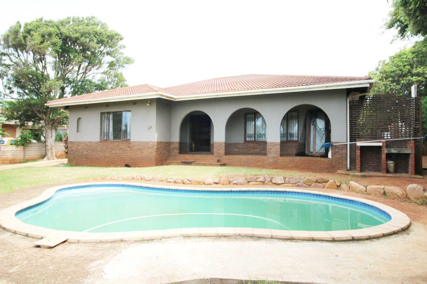 Front view of the house with braai area and pool