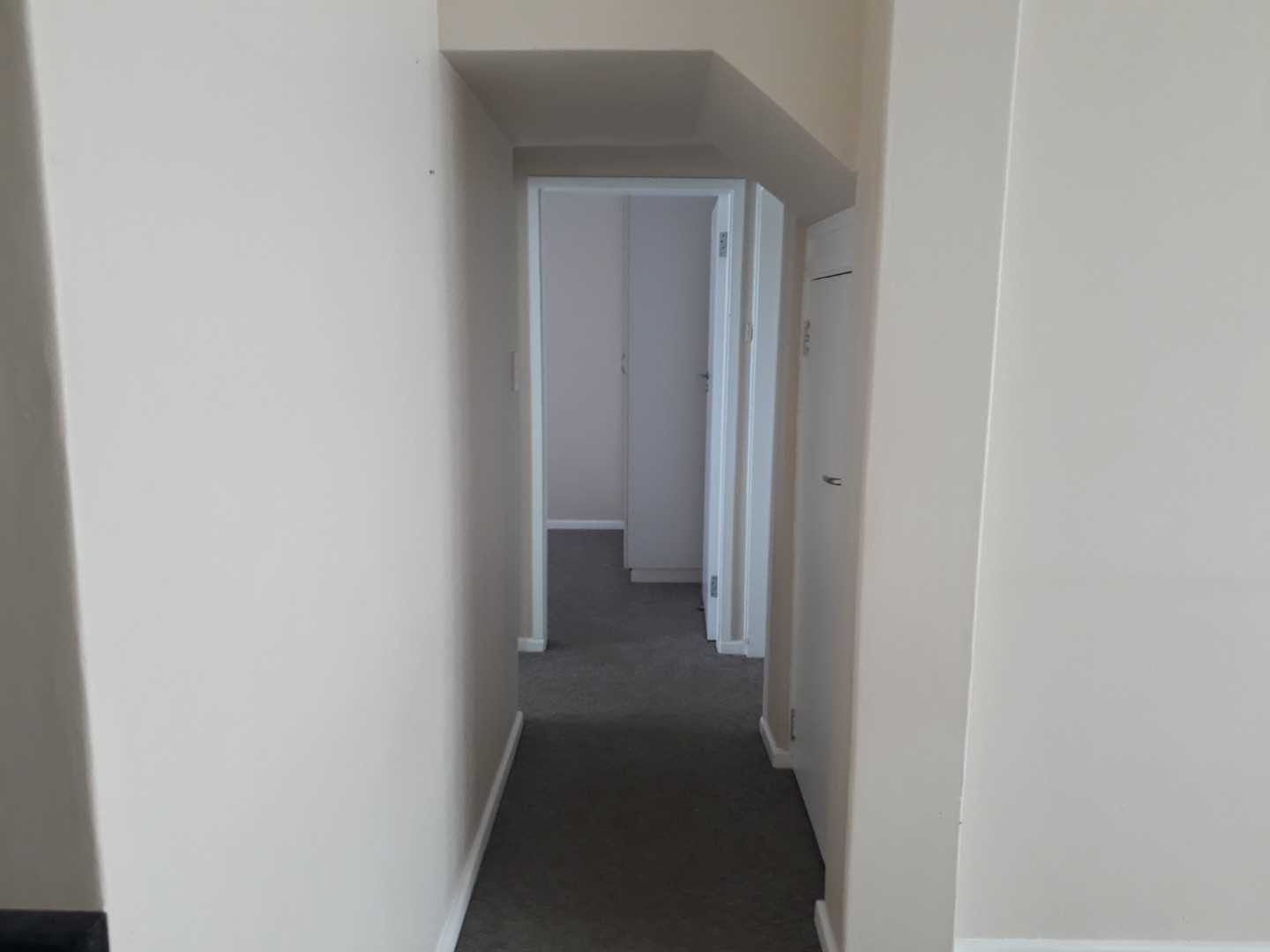 Passage leading to main bathroom and two bedrooms of which one is another en suite