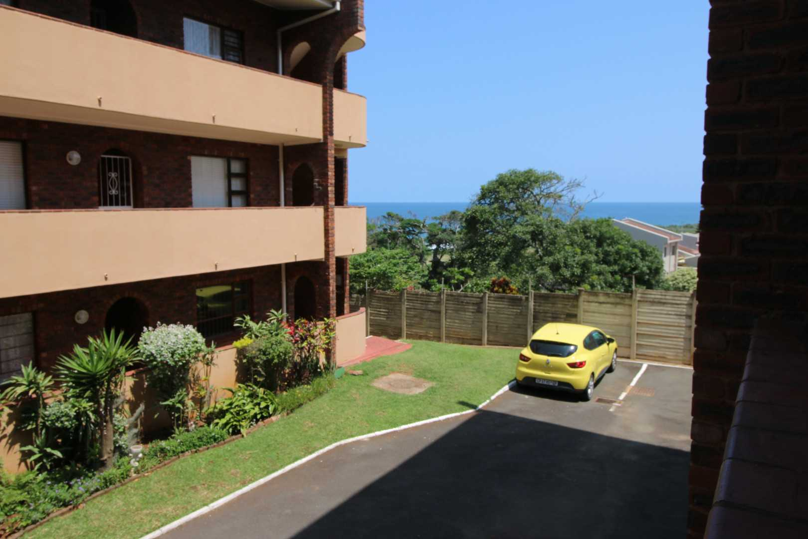 View from the balcony with seaview and guest parking in complex