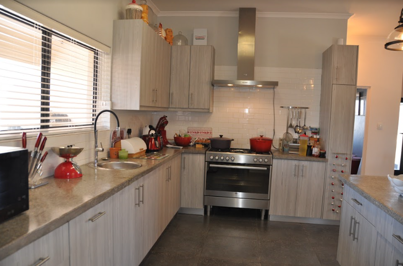 The kitchen has a free-standing stove and breakfast bar